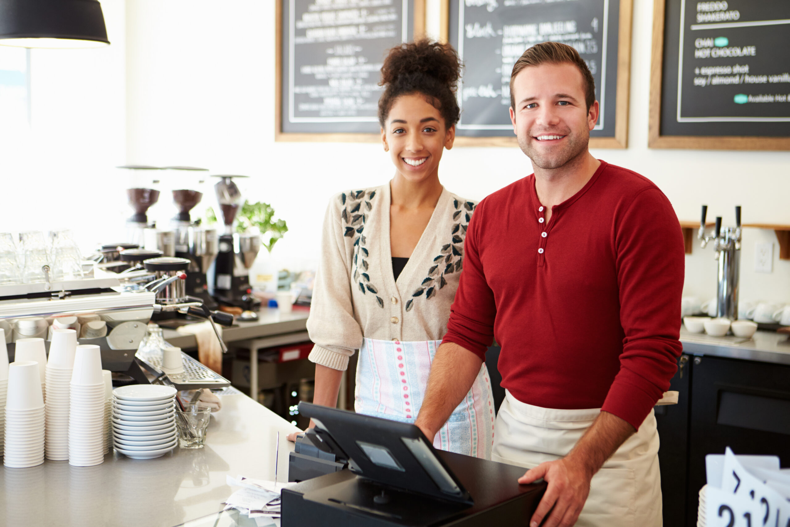 younger business owners with amherst alarm security system coffee shop